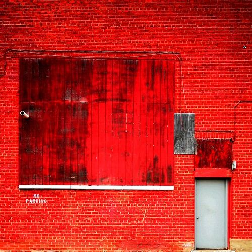 a red brick wall in the colour of a brick-red crayola