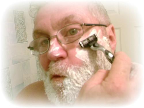 Self Portrait of a Shaving, Bearded Man