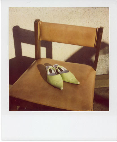 green shoes, brown chair