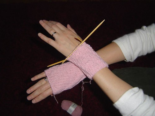 pink wrist warmers almost done