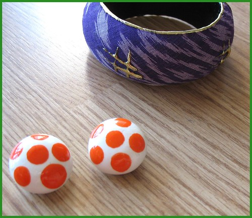 thrifted purple ikat bangle and orange polkadot clip-ons