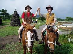 Dooshik and Greg riding a horse