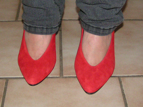 Red suede shoes.
