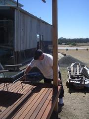 john measuring for location of veranda posts.jpg