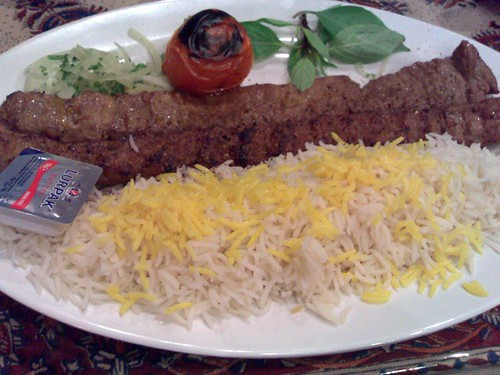 The flat lighter colored one on top is the Kebab Barg, while the darker rounder one is the Kebab Koobideh.  Note that this is from Banoo, not Shiraz.