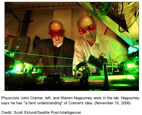 Physicists John Cramer, left, and Warren Nagourney work in the lab. Nagourney says he has